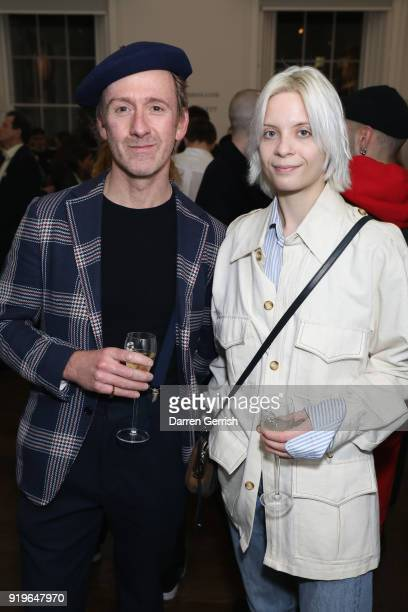 Tom Stubbs and guest attend the MATCHESFASHIONCOM X KATHARINE HAMNETT LFW SS18 event at ICA on February 17 2018 in London England