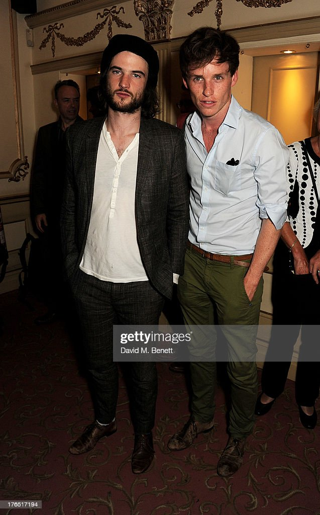 Tom Sturridge (L) and Eddie Redmayne pose in the foyer following the press night performance of 'A Doll's House' at the Duke Of Yorks Theatre on August 14, 2013 in London, England.