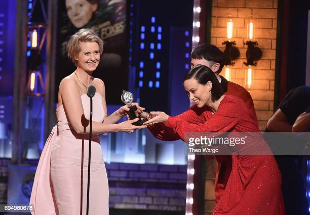 """Tom Sturridge and Olivia Wilde present Cynthia Nixon with the award for Best Performance by an Actress in a Featured Role in a Play for """"Lillian..."""