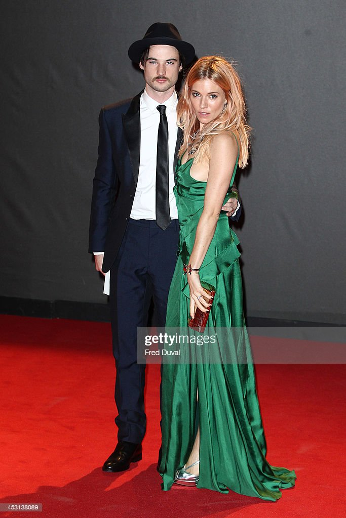 Tom Sturridge and Sienna Miller attend the British Fashion Awards 2013 at London Coliseum on December 2, 2013 in London, England.