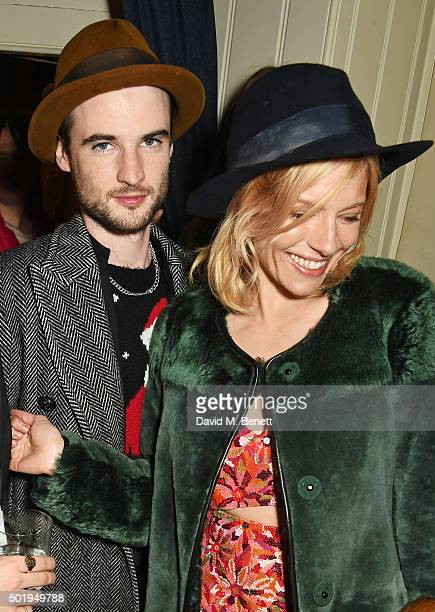 Tom Sturridge and Sienna Miller attend the LOVE Christmas party at George on December 18 2015 in London England