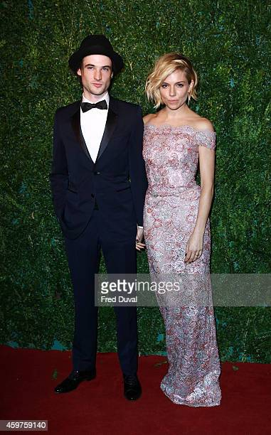 Tom Sturridge and Sienna Miller attends the 60th London Evening Standard Theatre Awards at London Palladium on November 30 2014 in London England