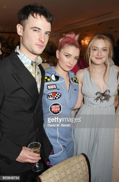 Tom Sturridge Eve Hewson and Dakota Fanning attend the LOVE x Miu Miu Women's Tales dinner hosted by Katie Grand and Elle Fanning at Loulou's on...
