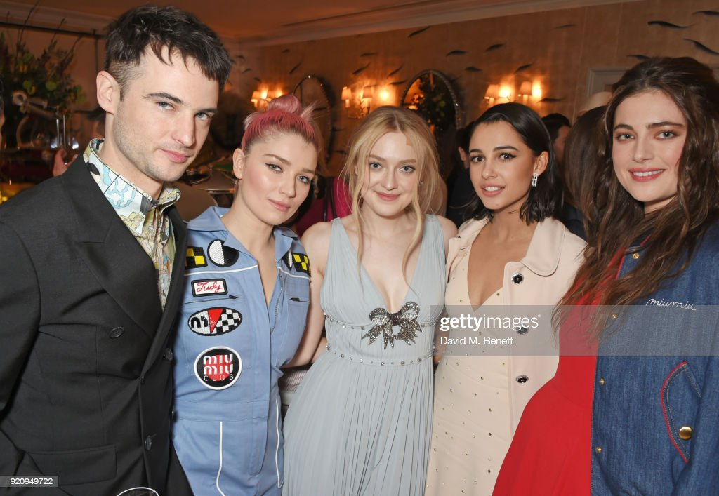 Tom Sturridge, Eve Hewson, Dakota Fanning, Naomi Scott and Millie Brady attend the LOVE x Miu Miu Women's Tales dinner hosted by Katie Grand and Elle Fanning at Loulou's on February 19, 2018 in London, England.