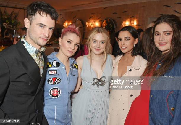 Tom Sturridge Eve Hewson Dakota Fanning Naomi Scott and Millie Brady attend the LOVE x Miu Miu Women's Tales dinner hosted by Katie Grand and Elle...