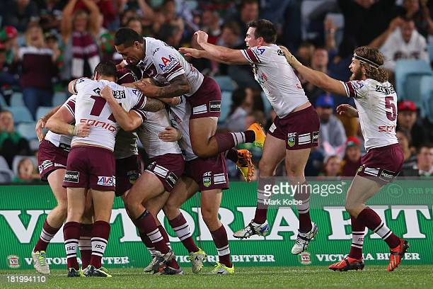 Tom Symonds of the Eagles is congratulated by his team mates after scoring a try during the NRL Preliminary Final match between the South Sydney...