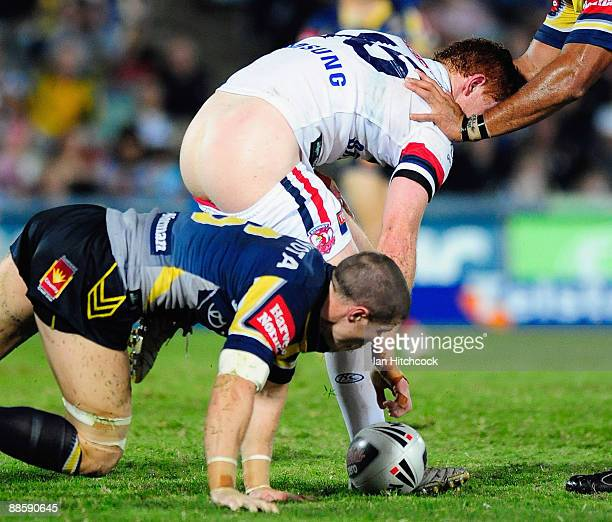 Tom Symonds of the Roosters loses his pants after being tackled during the round 15 NRL match between the North Queensland Cowboys and the Sydney...