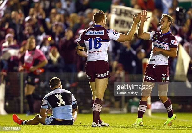 Tom Symonds of the Sea Eagles celebrates his try with team mate Daly Cherry Evans during the round 15 NRL match between the CronullaSutherland Sharks...