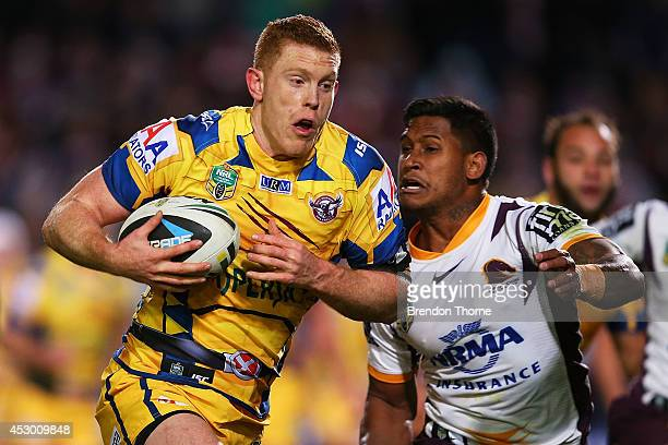Tom Symonds of the Sea Eagles is tackled by Ben Barba of the Broncos during the round 21 NRL match between the ManlyWarringah Sea Eagles and the...