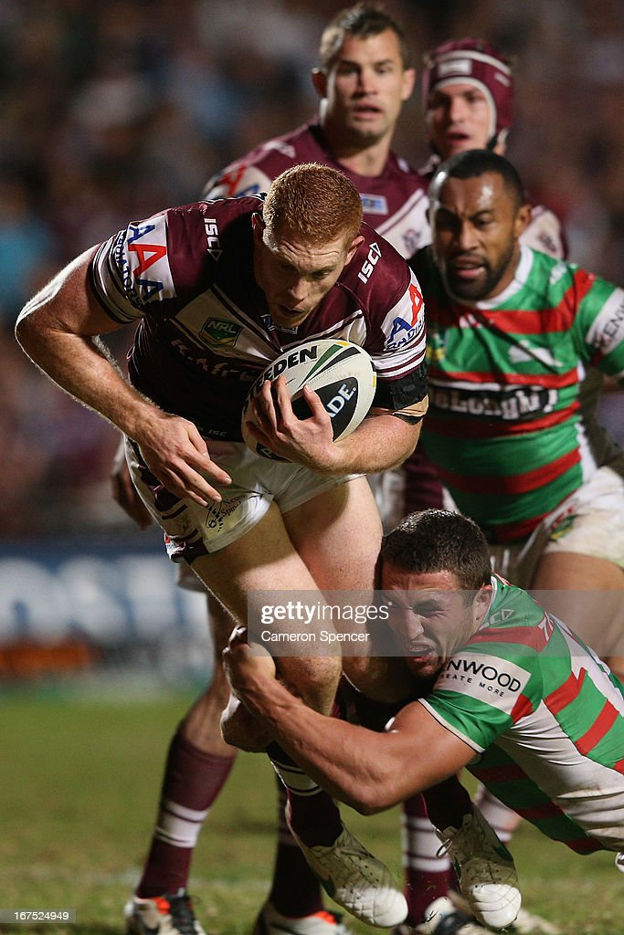 Tom Symonds of the Sea Eagles is tackled during the round seven NRL match between the Manly Sea Eagles and the South Sydney Rabbitohs at Brookvale Oval on April 26, 2013 in Sydney, Australia.