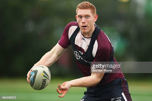 Tom Symonds of the Sea Eagles passes the ball during a Manly Sea Eagles NRL training session at Narrabeen Sports High School on August 27 2014 in...
