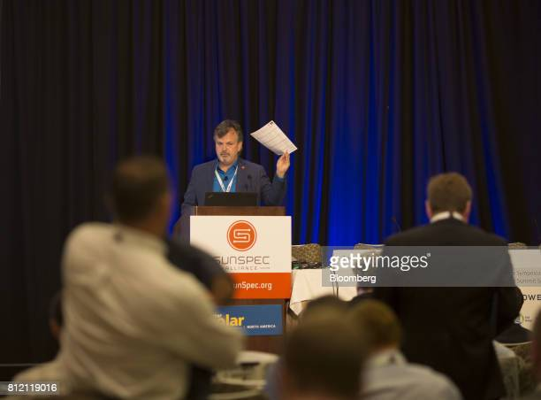 Tom Tansy, chairman of SunSpec Alliance, holds a piece of paper while speaking during the Intersolar North America Conference in San Francisco,...