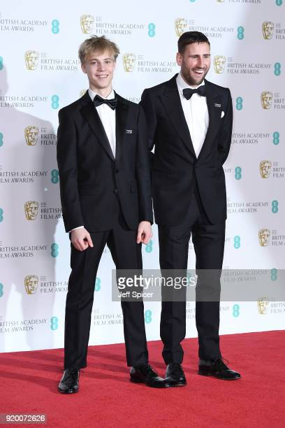 Tom Taylor and Edward Holcroft pose in the press room during the EE British Academy Film Awards held at Royal Albert Hall on February 18 2018 in...