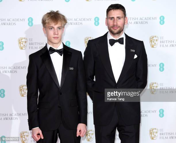 Tom Taylor and Edward Holcroft pose in the press room during the EE British Academy Film Awards held at the Royal Albert Hall on February 18 2018 in...
