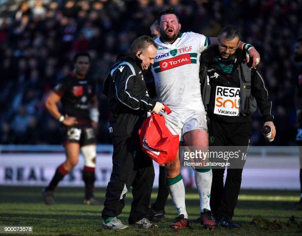 Tom Taylor leaves the pitch injured during the Top 14 match between Lyon OU and Pau on December 31 2017 in Lyon France