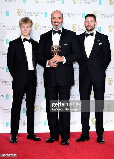 Tom Taylor Mark Bridges and Edward Holcroft with the Costume design award in the press room at the EE British Academy Film Awards held at the Royal...