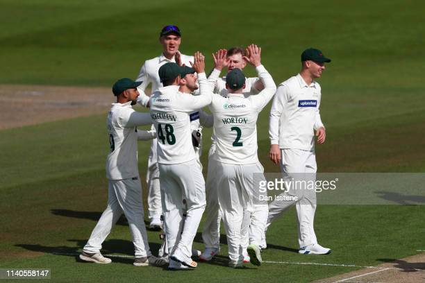 Tom Taylor of Leicestershire celebrates with teammates after claiming the wicket of Luke Wells of Sussex during the Specsavers County Championship...