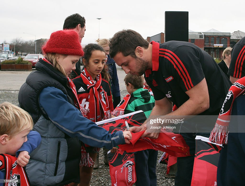 Tom Taylor of the Crusaders sign autographs after a media announcement that BNZ will be naming rights sponsor of the Crusaders on July 19, 2013 in Christchurch, New Zealand.