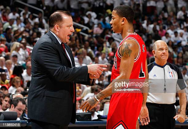 Tom Thibodeau converses with Derrick Rose of the Chicago Bulls against the Atlanta Hawks in Game Four of the Eastern Conference Semifinals in the...