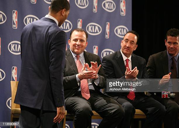Tom Thibodeau Gar Forman and Tom Chaney applaud Derrick Rose of the Chicago Bulls after he accepts the 201011 Kia NBA Most Valuable Player Award on...