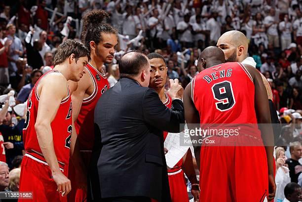 Tom Thibodeau of the Chicago Bulls converses huddles with Kyle Korver, Joakim Noah, Derrick Rose, Carlos Boozer and Luol Deng against the Atlanta...