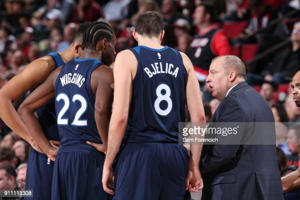 Tom Thibodeau talks to Nemanja Bjelica and Andrew Wiggins of the Minnesota Timberwolves on January 24 2018 at the Moda Center Arena in Portland...