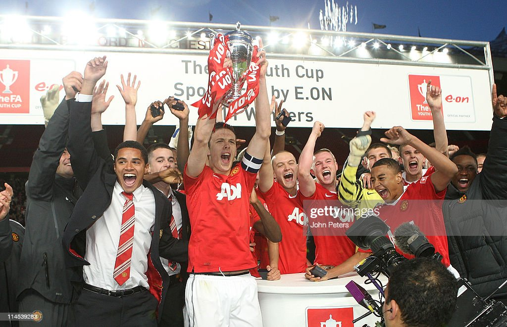 Tom Thorpe of Manchester United Academy Under-18s lifts the FA Youth Cup trophy after the FA Youth Cup Final Second Leg match between Manchester United Academy Under-18s and Sheffield United Academy Under-18s at Old Trafford on May 23, 2011 in Manchester, England.