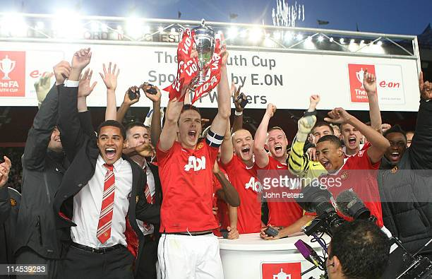 Tom Thorpe of Manchester United Academy Under18s lifts the FA Youth Cup trophy after the FA Youth Cup Final Second Leg match between Manchester...