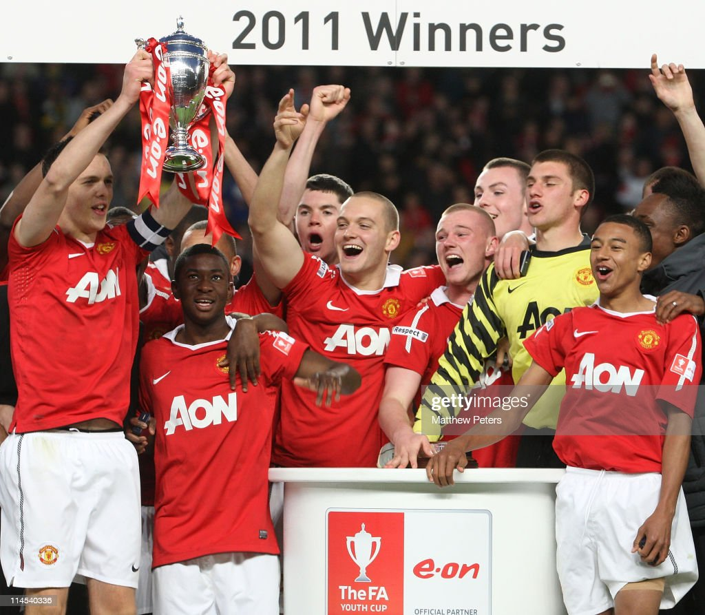 Tom Thorpe (L) of Manchester United Academy Under-18s lifts the FA Youth Cup trophy after the FA Youth Cup Final Second Leg match between Manchester United Academy Under-18s and Sheffield United Academy Under-18s at Old Trafford on May 23, 2011 in Manchester, England.