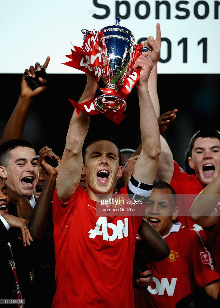 Tom Thorpe of Manchester United lifts the Trophy in celebration during the FA Youth Cup Final 2nd Leg match between Manchester United and Sheffield United at Old Trafford on May 23, 2011 in Manchester, England.