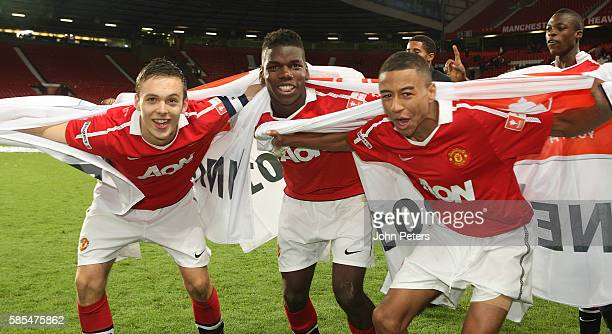 Tom Thorpe Paul Pogba and Jesse Lingard of Manchester United Academy Under18s celebrate with the FA Youth Cup trophy after the FA Youth Cup Final...