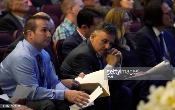 Tom Tonelli a teacher at Columbine High School sits with former Columbine principal Frank DeAngelis as they attend a service on April 18 2019 in...