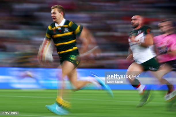 Tom Trbojevic of Australia breaks away to score a try during the 2017 Rugby League World Cup match between Australia and Lebanon at Allianz Stadium...