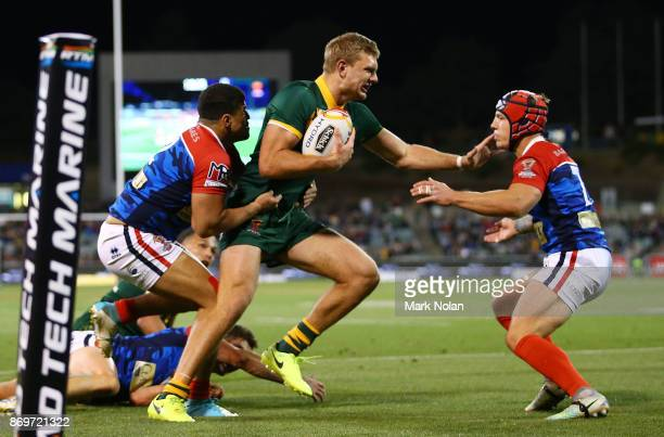 Tom Trbojevic of Australia is tackled during the 2017 Rugby League World Cup match between Australian Kangaroos and France at Canberra Stadium on...
