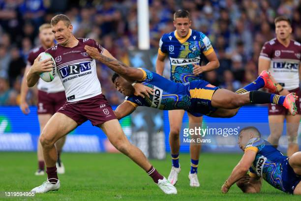 Tom Trbojevic of Manly is tackled by Waqa Blake of the Eels during the round 11 NRL match between the Parramatta Eels and the Manly Sea Eagles at...