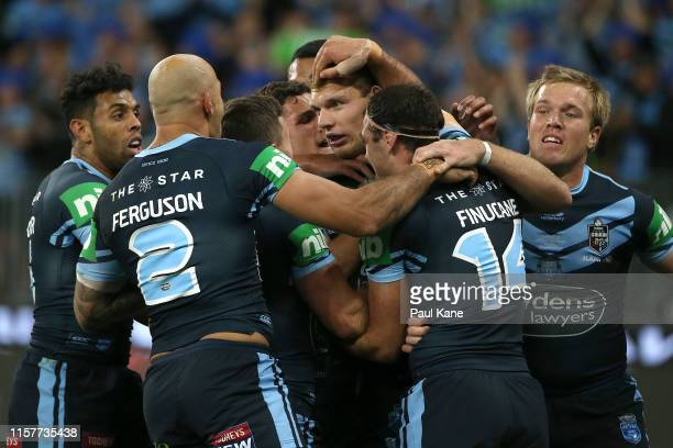 Tom Trbojevic of New South Wales is congratulated by team mates after crossing for try during game two of the 2019 State of Origin series between the...