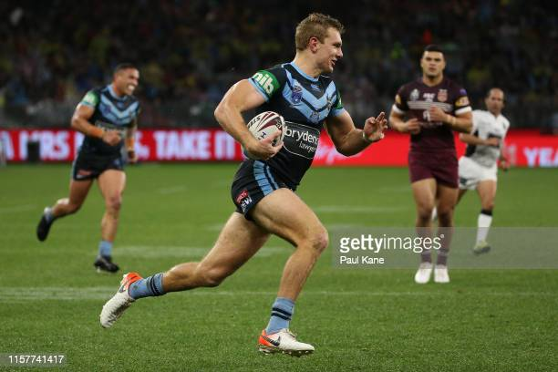 Tom Trbojevic of New South Wales runs in for a try during game two of the 2019 State of Origin series between the New South Wales Blues and the...