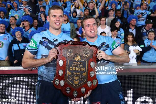 Tom Trbojevic of the Blues and Jake Trbojevic of the Blues pose with the trophy following game three of the State of Origin series between the...