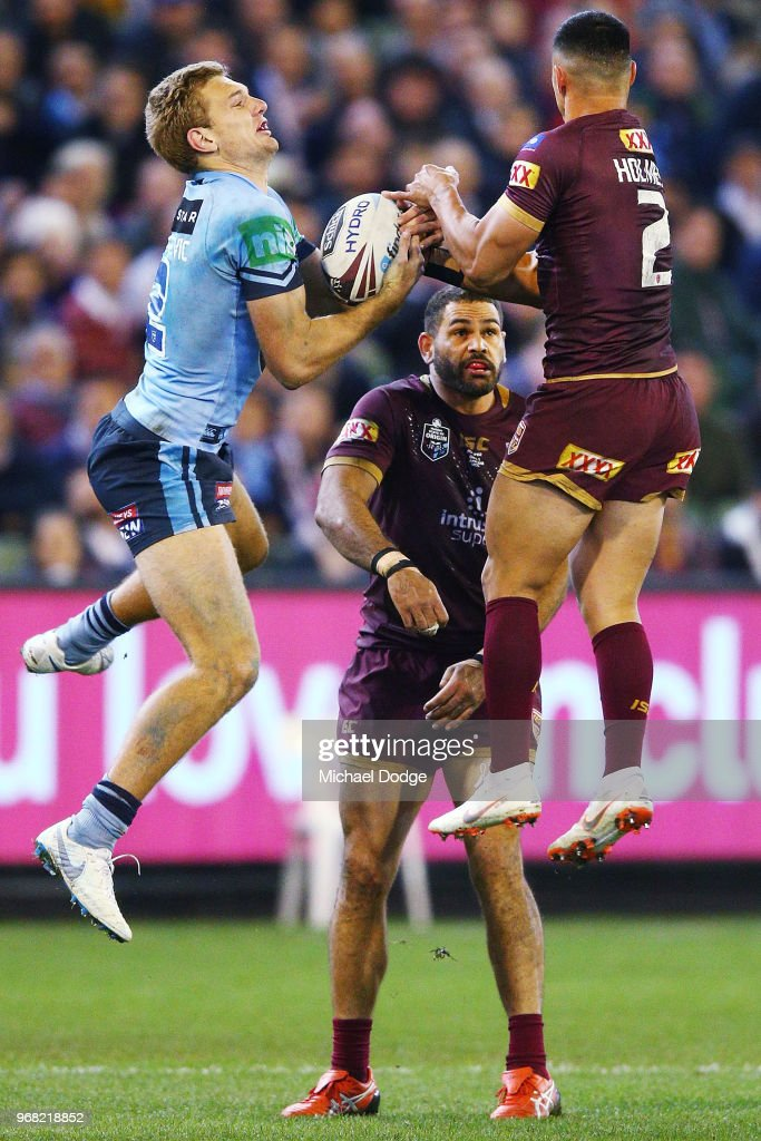 Tom Trbojevic of the Blues catches the ball against Valentine Holmes of the Maroons to then score a try during game one of the State Of Origin series between the Queensland Maroons and the New South Wales Blues at the Melbourne Cricket Ground on June 6, 2018 in Melbourne, Australia.