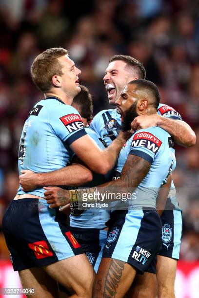 Tom Trbojevic of the Blues celebrates after scoring a try with James Tedesco and Josh Addo-Carr of the Blues during game two of the 2021 State of...