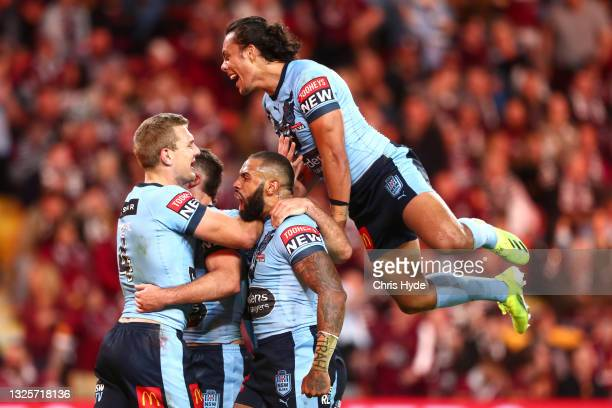 Tom Trbojevic of the Blues celebrates after scoring a try with James Tedesco, Josh Addo-Carr and Jarome Luai of the Blues during game two of the 2021...