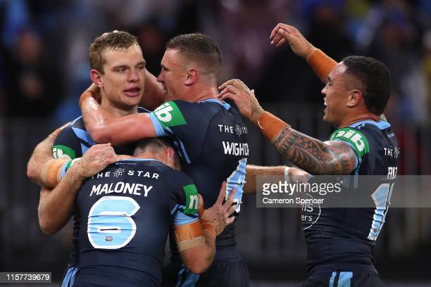 Tom Trbojevic of the Blues celebrates scoring a try during game two of the 2019 State of Origin series between the New South Wales Blues and the...