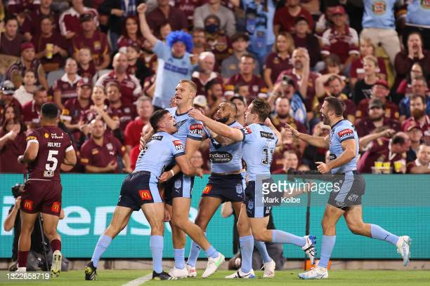 Tom Trbojevic of the Blues celebrates with team mates after scoring a try during game one of the 2021 State of Origin series between the New South...