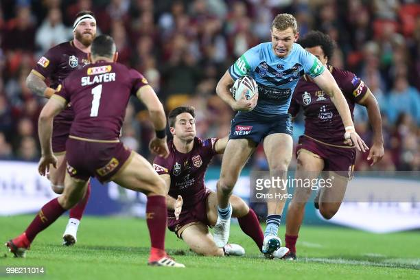 Tom Trbojevic of the Blues runs the ball during game three of the State of Origin series between the Queensland Maroons and the New South Wales Blues...