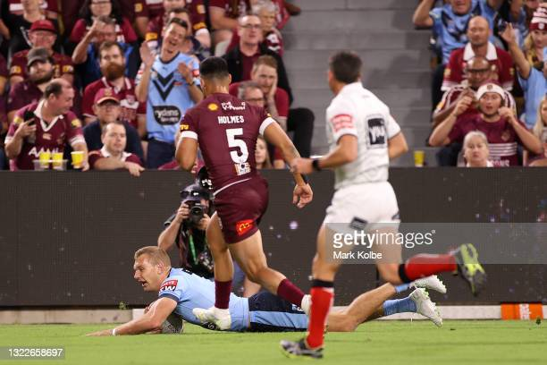 Tom Trbojevic of the Blues scores a try during game one of the 2021 State of Origin series between the New South Wales Blues and the Queensland...