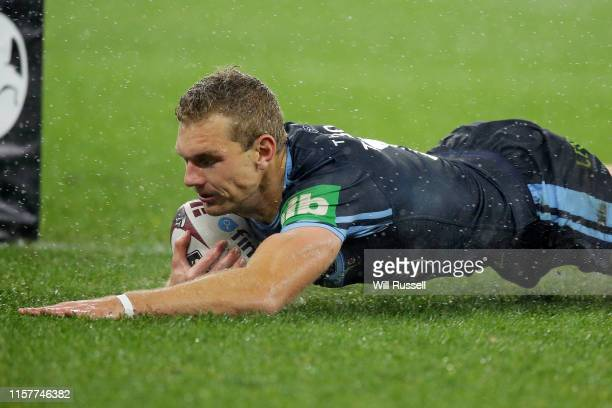Tom Trbojevic of the Blues scores a try during game two of the 2019 State of Origin series between the New South Wales Blues and the Queensland...