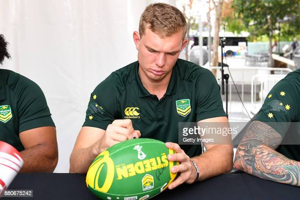 Tom Trbojevic of the Kangaroos signs autographs during an Australia Kangaroos and England Signing Session at Reddacliff Place on November 28 2017 in...