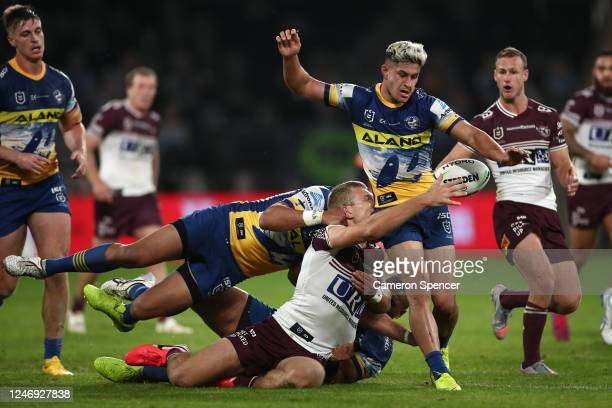 Tom Trbojevic of the Sea Eagles attempts to pass around Dylan Brown of the Eels during the round four NRL match between the Parramatta Eels and the...