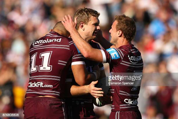 Tom Trbojevic of the Sea Eagles celebrates scoring a try during the round 22 NRL match between the Manly Warringah Sea Eagles and the Sydney Roosters...