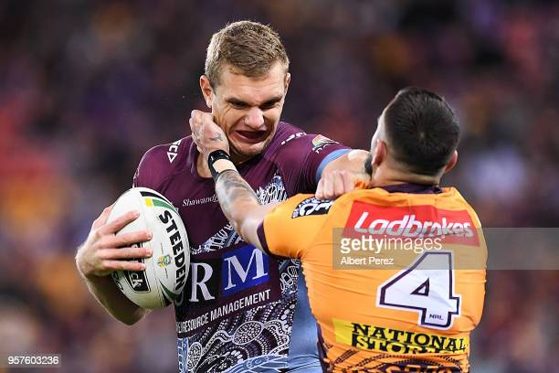 Tom Trbojevic of the Sea Eagles fends off a tackle from Jack Bird of the Broncos during the round ten NRL match between the Manly Sea Eagles and the...